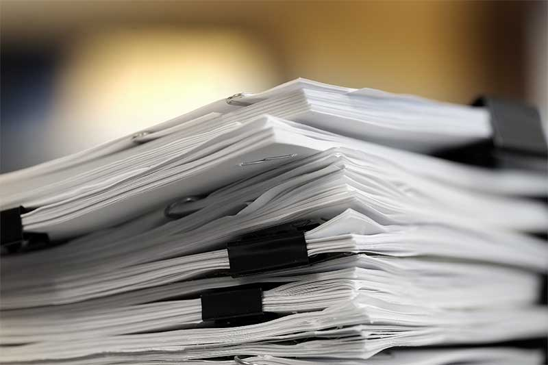 Pile of contract documents