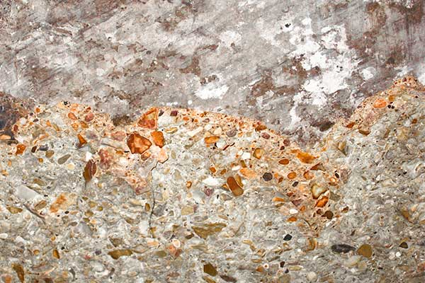 Fire damaged concrete exhibiting pinking