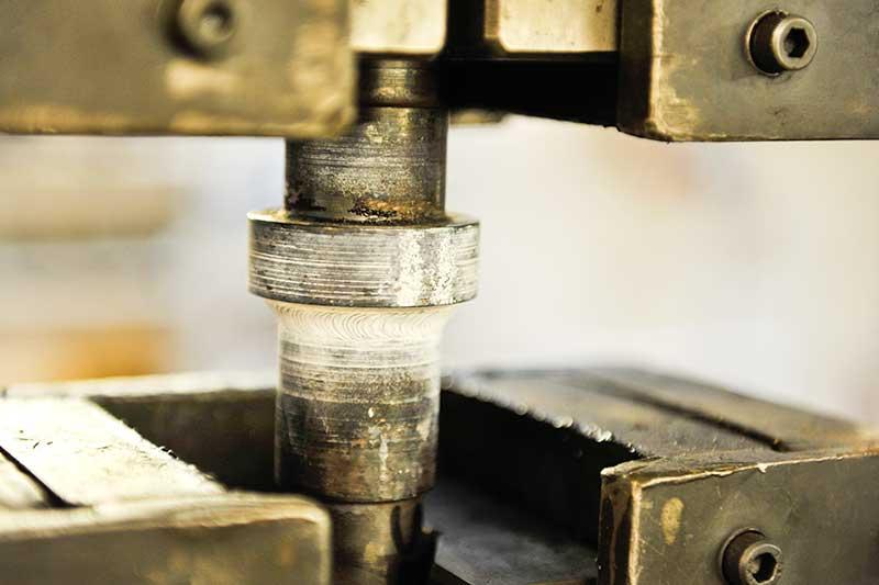 Metal sample being tested