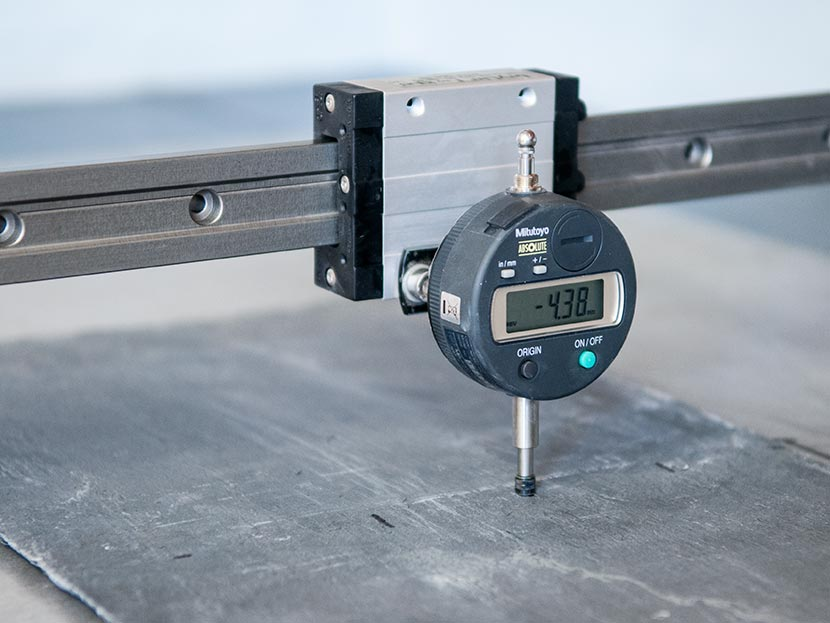 Dimension measurement of stone using a dial gauge